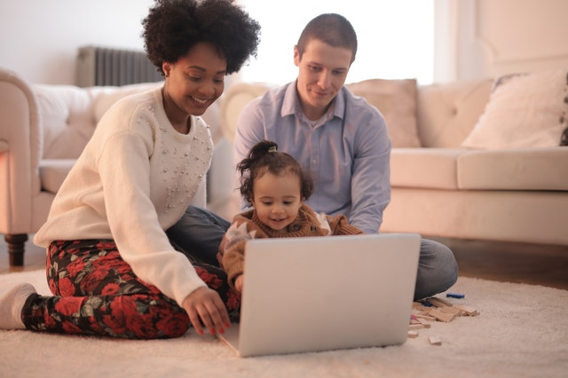 Young family on laptop